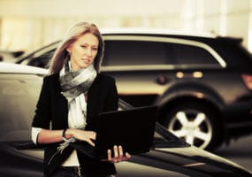 business woman with new car from Brisbane Car Broker