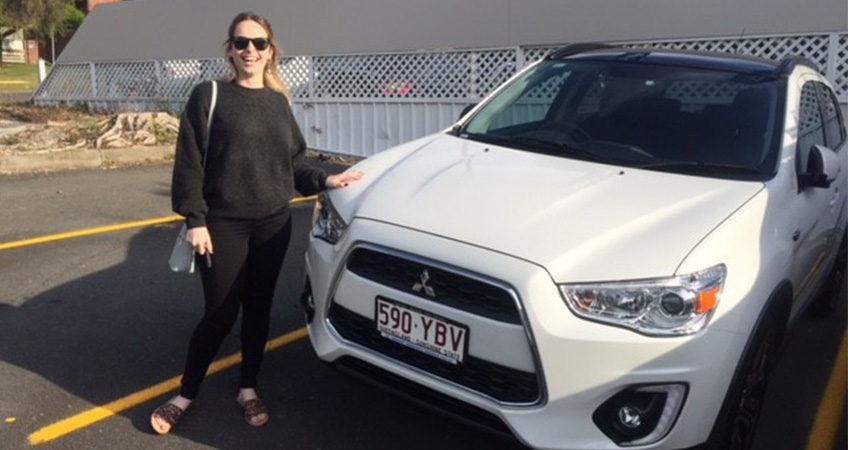 Happy customer Kaylene with her brand new Mitsubishi ASX from Brisbane Car Brokers