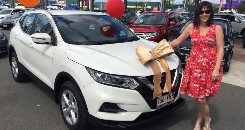 Brisbane Car Broker's customer Leanne, with her brand new Nissan